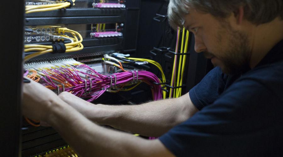 Torsten Kilias, M. Sc. working on a server